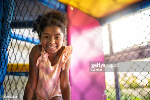 afro latinx girl playing at playground portrait - afro caribbean ethnicity stock pictures, royalty-free photos & images