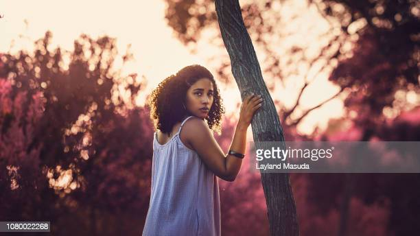 Afro Latinx Young Woman Standing Outdoors