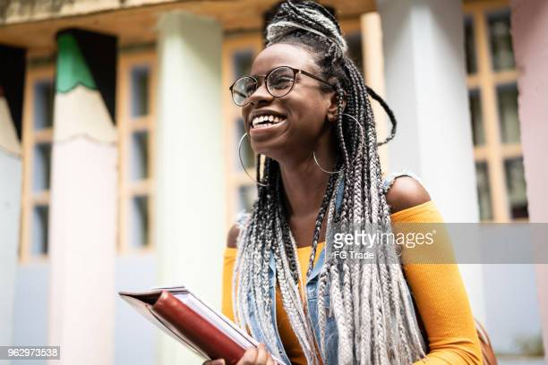 afro student/teacher on the move - college student stock pictures, royalty-free photos & images