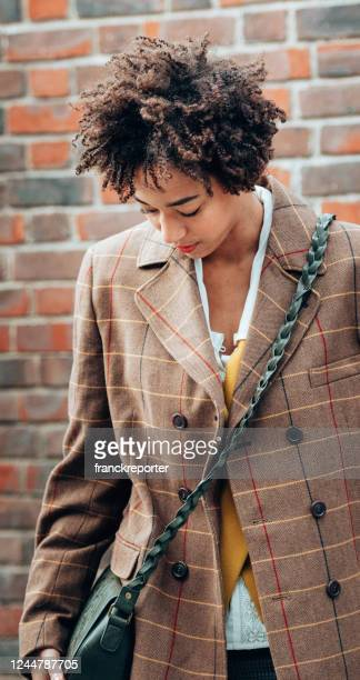 afro woman portrait on the streets - london fashion week street stock pictures, royalty-free photos & images