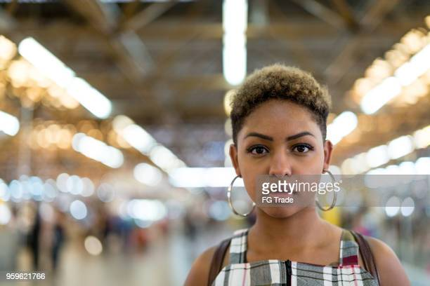 Afro young woman portrait at metro station
