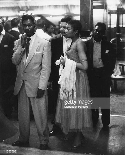 AfroAmerican customers waiting to enter the Savoy dance hall in Harlem New York February 1956