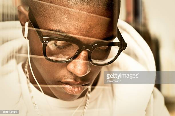 afro-american teenager listening to music - thick rimmed spectacles stock photos and pictures