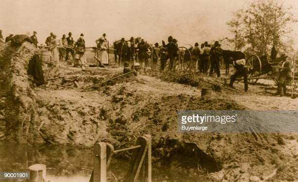 Afro-Americans with wagons at flood site, some digging, Johnstown, Pennsylvania