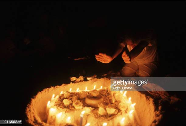 AfroBrazilian religious ritual at Copacabana beach in Rio de Janeiro Brazil during New Year celebration offerings to the entities