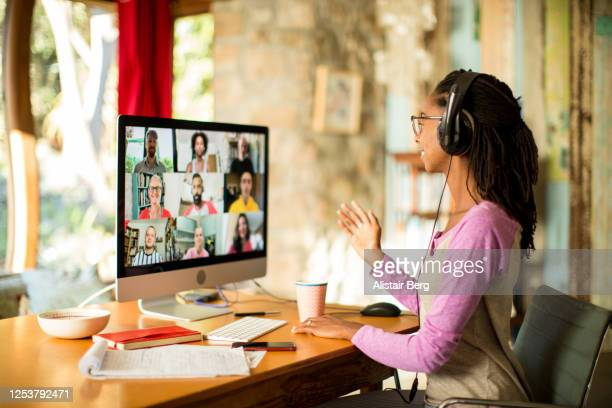 afro-caribbean woman on video call from home during the covid lockdown - video conference stock pictures, royalty-free photos & images
