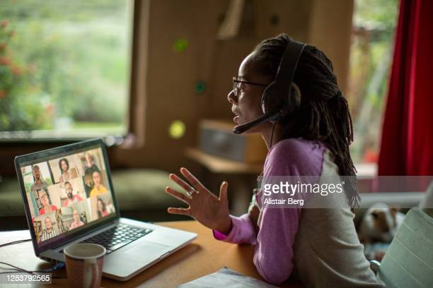 afro-caribbean woman working from home during the covid lockdown - home office stock pictures, royalty-free photos & images