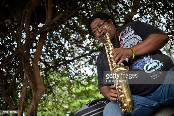 AfroColombian musician Cesar Aguilar plays the saxophone on AfroColombian Day on May 21 in Cali Colombia celebrating the 165th anniversary of the...