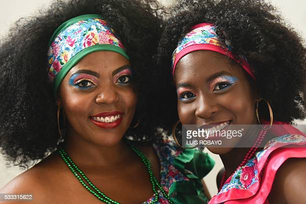 AfroColombian women pose for a photo on AfroColombian Day on May 21 in Cali Colombia celebrating the 165th anniversary of the abolition of slavery in...
