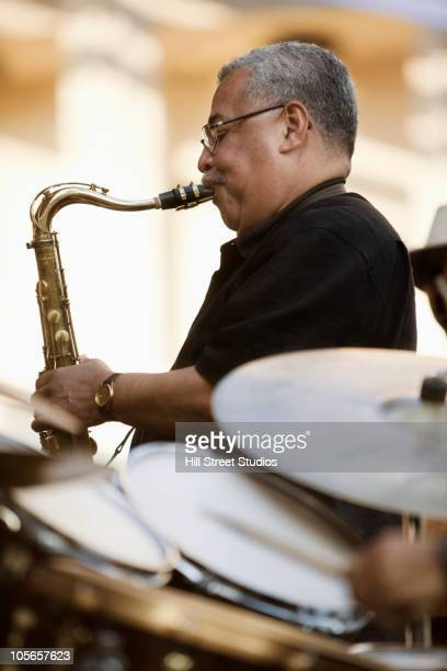 Afro-Columbian man playing saxophone