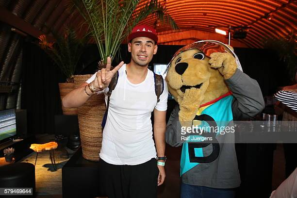 Afrojack and BreuniBaer mascot of Breuninger pose for a photograph at the ParookaVille Festival on July 15 2016 in Weeze Germany
