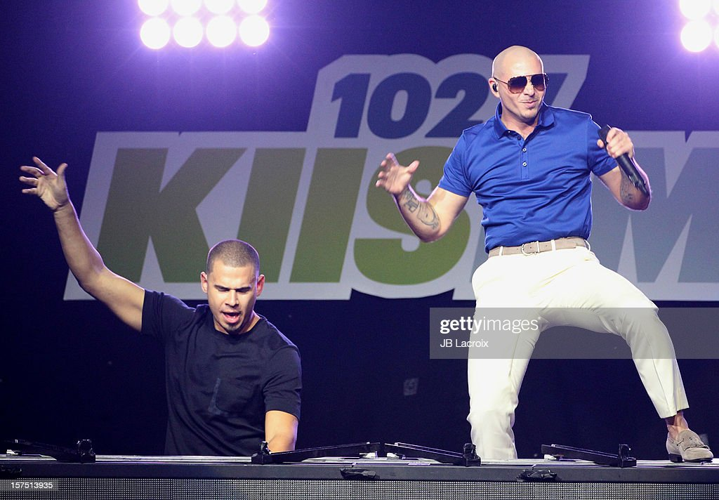 Afrojack and Pitbull perform onstage during KIIS FM's 2012 Jingle Ball at Nokia Theatre LA Live on December 3, 2012 in Los Angeles, California.