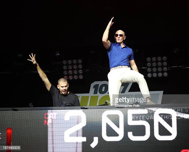 Afrojack and rapper Pitbull perform onstage during KIIS FM's 2012 Jingle Ball at Nokia Theatre LA Live on December 3 2012 in Los Angeles California
