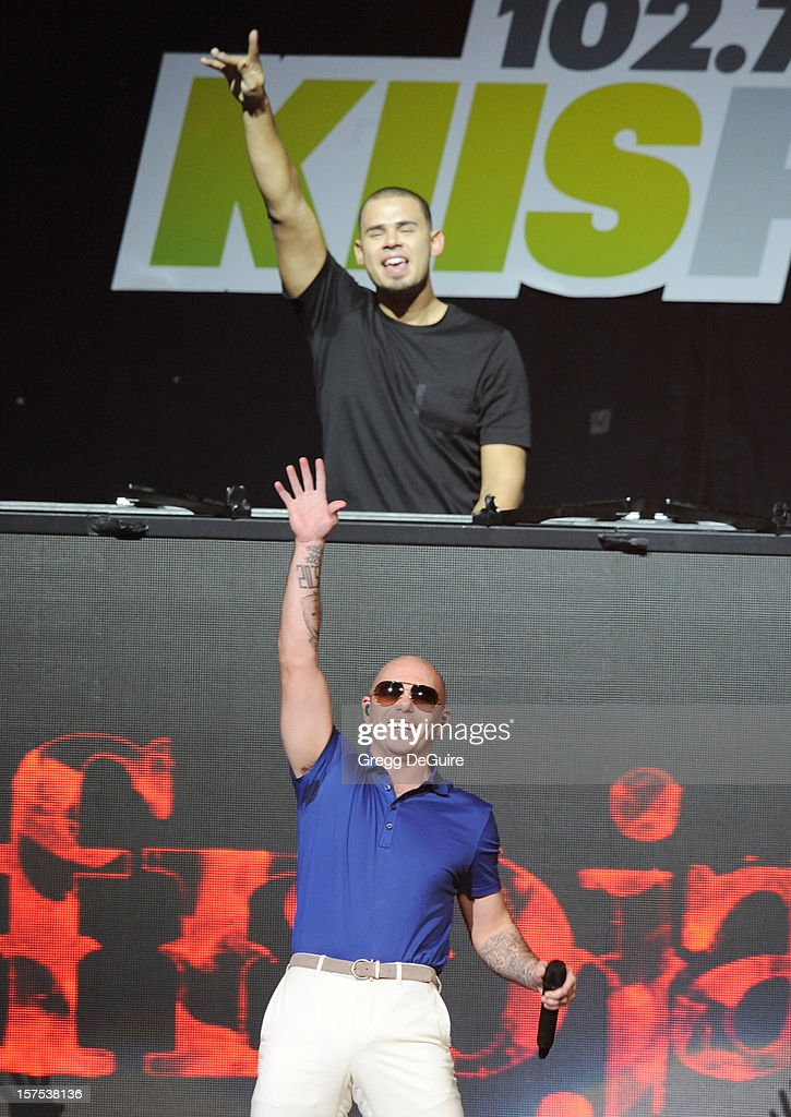 DJ Afrojack and singer Pitbull perform at KIIS FM's Jingle Ball 2012 night 2 at Nokia Theatre LA Live on December 3, 2012 in Los Angeles, California.