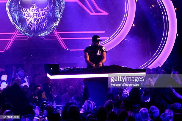 Afrojack performs onstage during the outside broadcast at the MTV EMA's 2013 on November 10 2013 in Amsterdam Netherlands