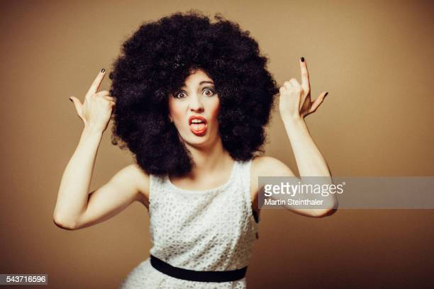 Afrostyled woman with a funny face