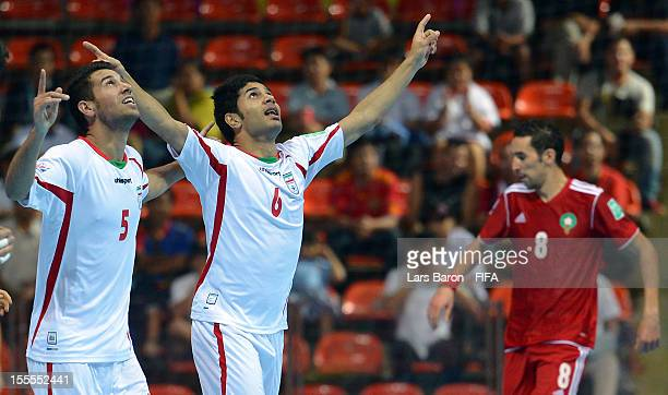 Afshin Kazemi of Iran celebrates after scoring his teams second goal during the FIFA Futsal World Cup Group B match between Morocco and Iran at...