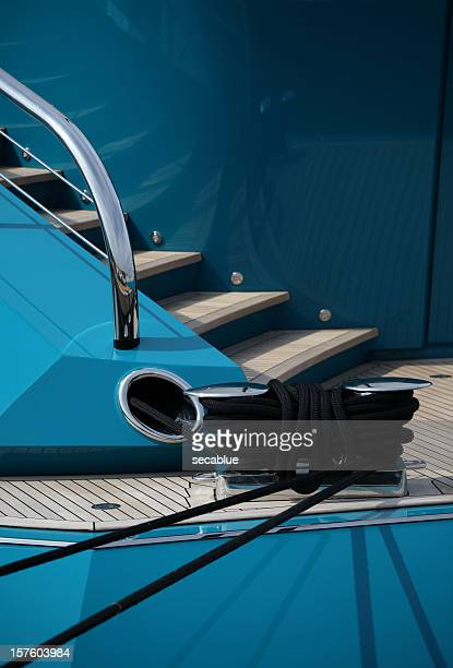 Aft of large blue yacht