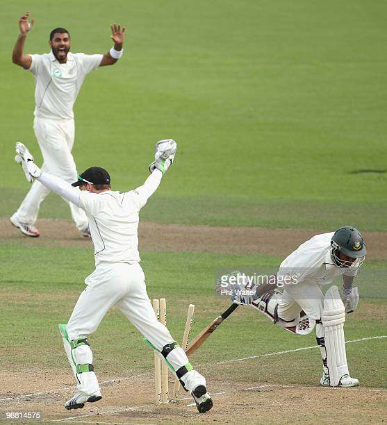 Aftab Ahmed of Bangladesh is run out by Jeetan Patel of New Zealand during day four of the First Test match between New Zealand and Bangladesh at...