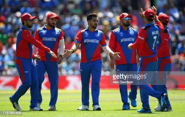 Aftab Alam of Afghanistan celebrates taking the wicket of Hardik Pandya of India with his teammates during the Group Stage match of the ICC Cricket...