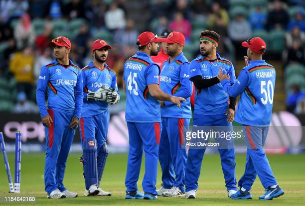 Aftab Alam of Afghanistan celebrates taking the wicket of Ross Taylor of New Zealand his teammates during the Group Stage match of the ICC Cricket...