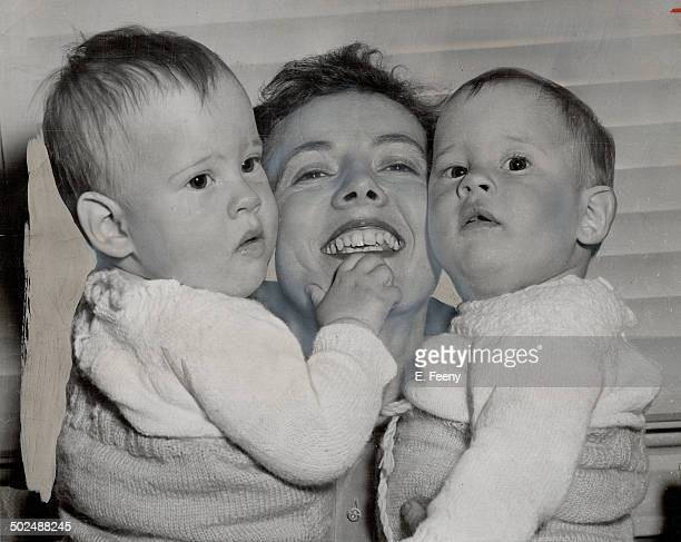 After 12 Hours of Anxiety Mrs Austin Hepton of Cooksville is shown reunited with her foster sons twins Ronald and Richard 11 months The babies were...