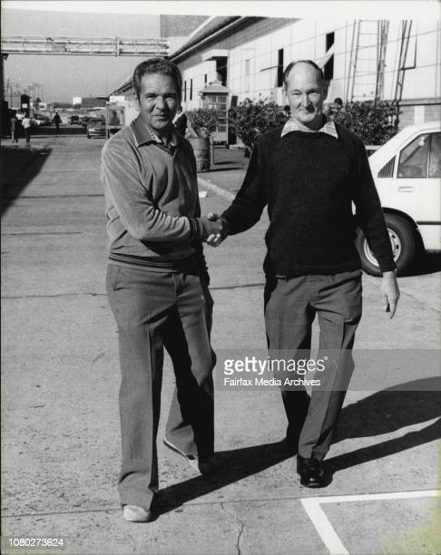 After 25 years of working side by side Arthur Bater and Jack Barrett shake hands for the last time as they leave Pagewood August 29 1980