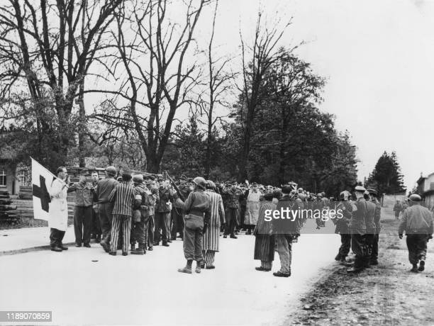 After 30 minutes of fighting in the concentration camp of Dachau, Germans prison guards and SS troops surrender to the Americans troops.