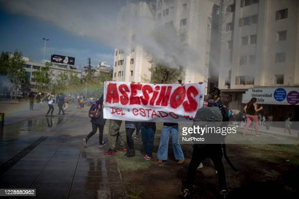After 6 months, protesters return to take the Plaza Baquedano in a new day of social protest against the government of Sebastian Pinera, in Santiago,...