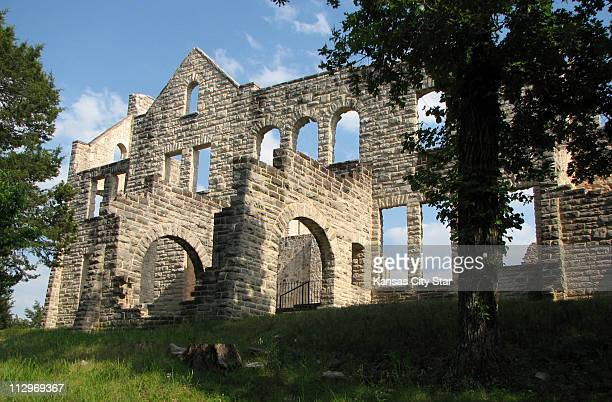 After a 1942 fire all that remains of a Kansas City tycoon's grand country home at the Lake of the Ozarks are its imposing sandstone walls