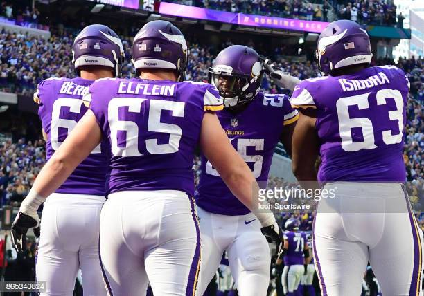 After a 29yard touchdown run Minnesota Vikings running back Latavius Murray is congratulated by Minnesota Vikings center Joe Berger Minnesota Vikings...