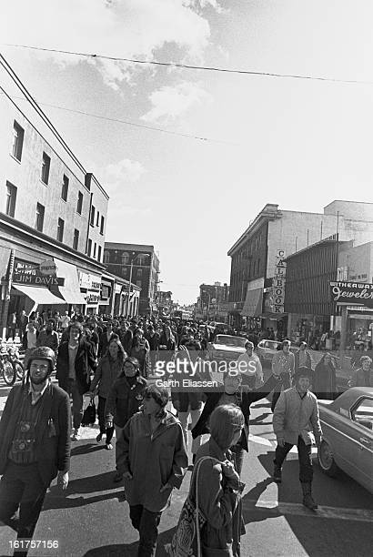 After a Black Panther demonstration on the University of California Berkeley campus marchers walk down Telegraph Avenue Berkely California March 28...