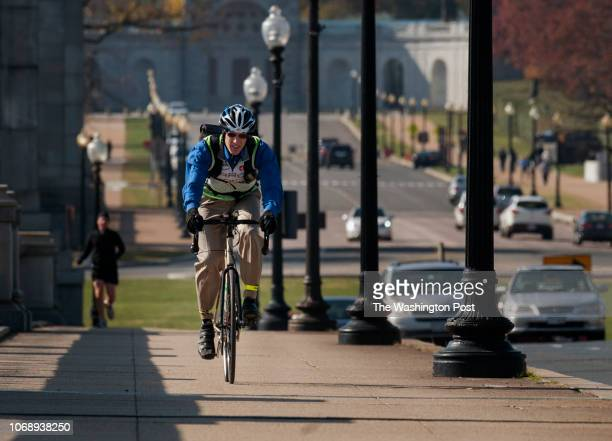 After a business appointment George Branyan leaves Rossyln VA riding over the Memorial Bridge to return to his office in Washington DC on Friday...