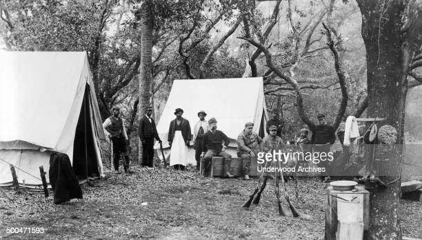 After a day of duck hunting President Grover Cleveland and his friends relax in camp at the mouth of the Santee River South Carolina 1897