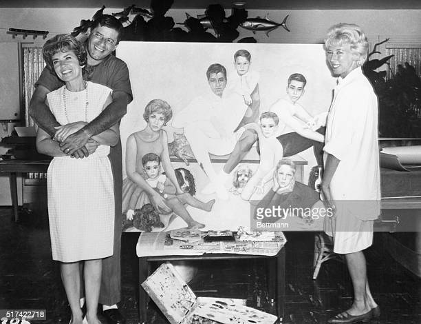 After a dozen zany sessions artist Margaret Keane stands proudly in front of a family portrait of the seven leaping Lewises plus pets The leading...