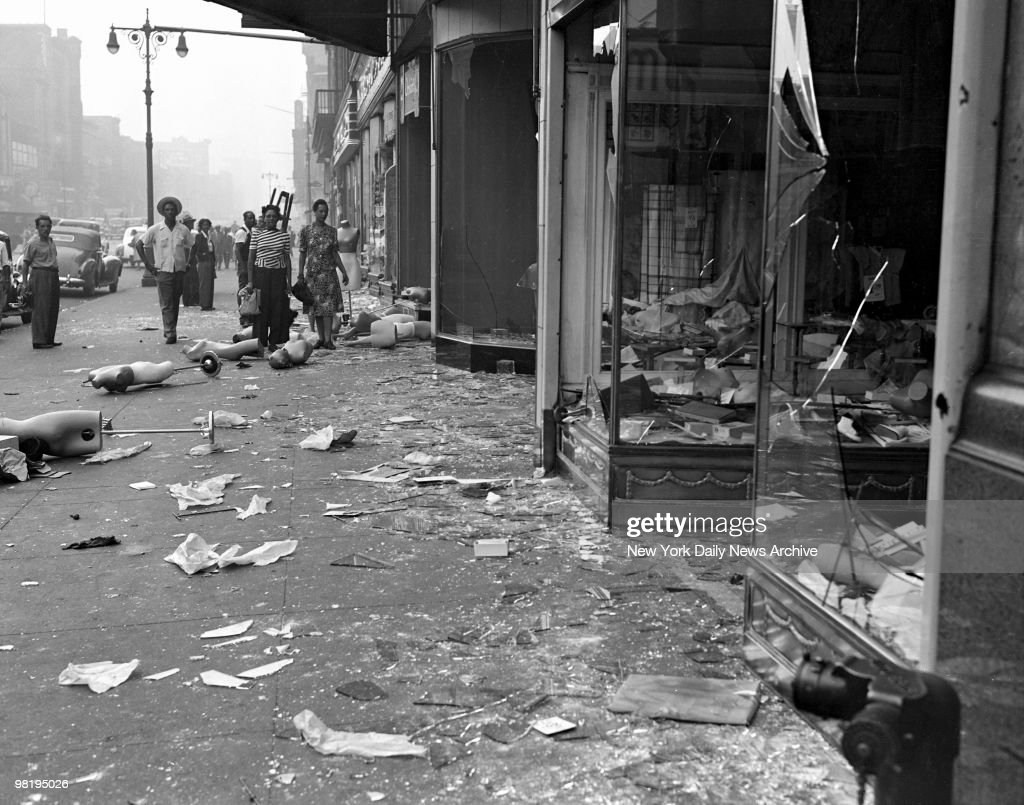 After a full night of rioting and looting Harlem was guarded last night by 2,500 police to prevent a recurrence of the violence which injured hundreds. Damage to stores was estimated at $5,000,000. Mrs. Erma Levy surveys the wrecked interior of her drygoods store at 374 Lenox Ave. on August 2, 1943 in Harlem, New York.