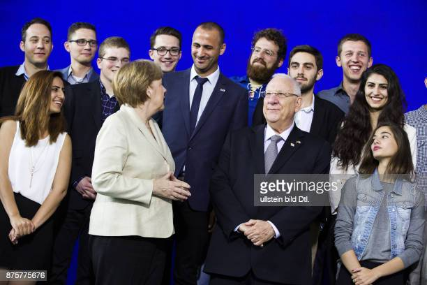 After a group photo Israeli President Reuven Rivlin and the Chancellor discuss on May 12 with twenty young people at the Federal Chancellery who...