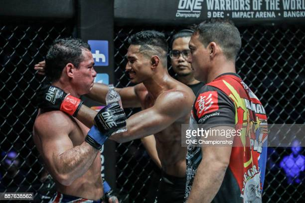 After a grueling threeround battle Adriang Pang and Amir Khan show true martial arts spirit at ONE Championship Immortal Pursuit at the Singapore...