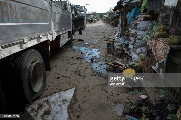 After a gun battle a street is empty as Philippine Marines clear the area from armed militants on May 28 2017 in Marawi city southern Philippines...