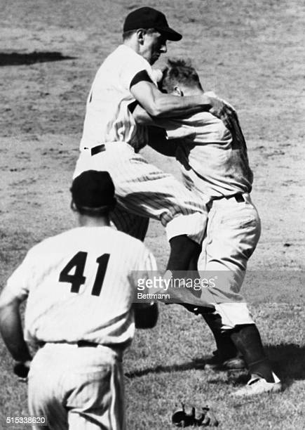 After a heated exchange of punches Clint Courtney of the St Louis Browns and Billy Martin of the New York Yankees continue their brawl in...