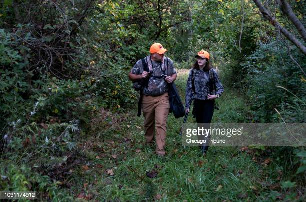 After a hunt Bryan McFadden and his daughter Adrianna walk through the woods to their vehicle in Pine Township Ind in a 2017 photo
