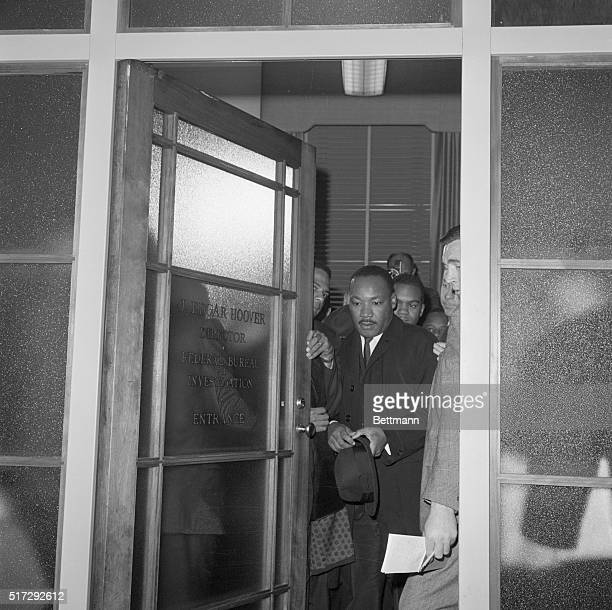 After a meeting with FBI Director J Edgar Hoover Reverend Martin Luther King leaves the FBI building in Washington DC