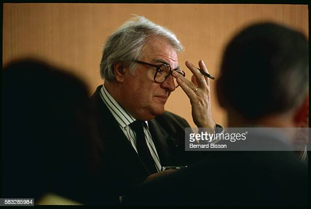 After a morning work session with various deputies First Secretary of the Socialist Party Pierre Mauroy attends a meeting concerning the TGV signs an...