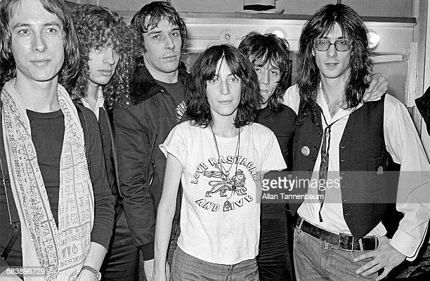 After a performance American musician and poet Patti Smith and her group pose with John Cale backstage at the Bottom Line New York New York December...