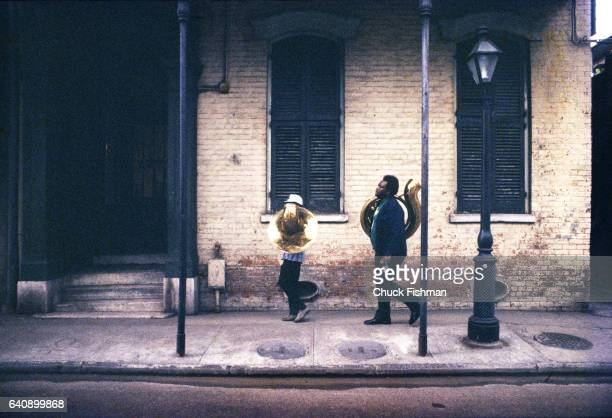 After a performance American musician Anthony 'Tuba Fats' Lacen along with an unnamed assistant carry parts of his instrument as they walk along...