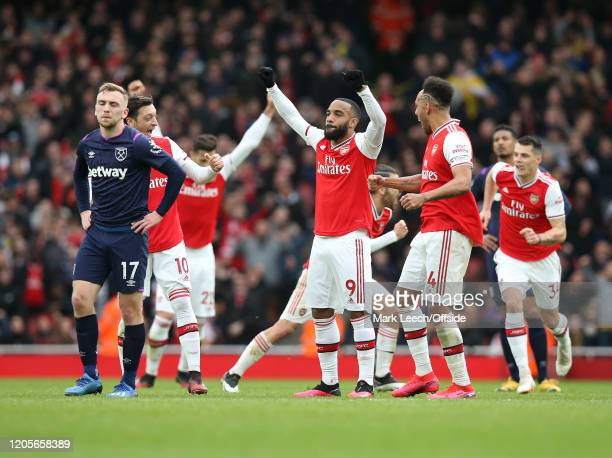 after a prolonged period of VAR scrutiny the goal by Alexandre Lacazette of Arsenal is given and the Arsenal celebrations begin during the Premier...