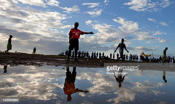 After a rainstorm a game of soccer is played on flooded field April 15 2012 in Dili East Timor Millions have been spent on aid during the first 10...