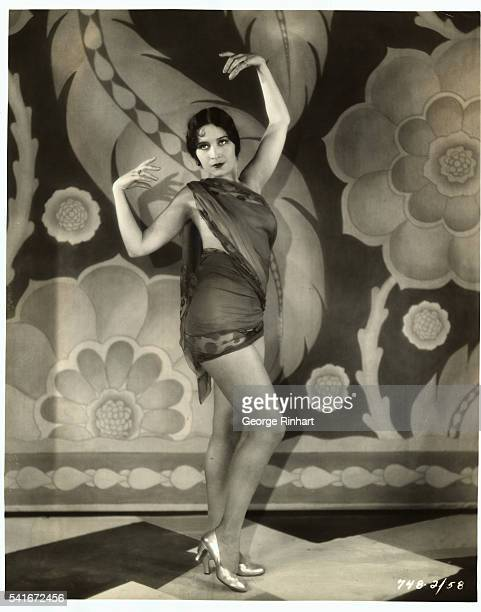 After a search throughout Hollywood Paramount found this girl who consented to have her body gilded for an elaborate theatrical revue in the talking...