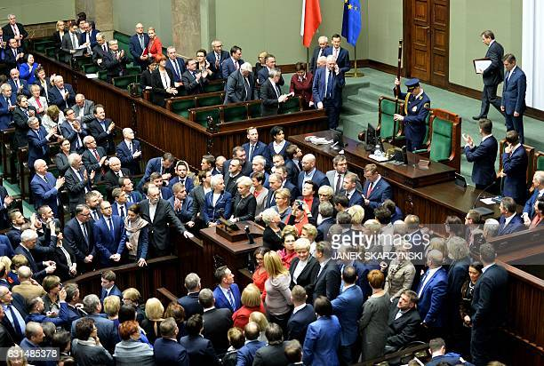 After a sevenhour delay speaker of Parliament Marek Kuchcinski formally opens a new session of Poland's parliament on January 11 2017 evening in...