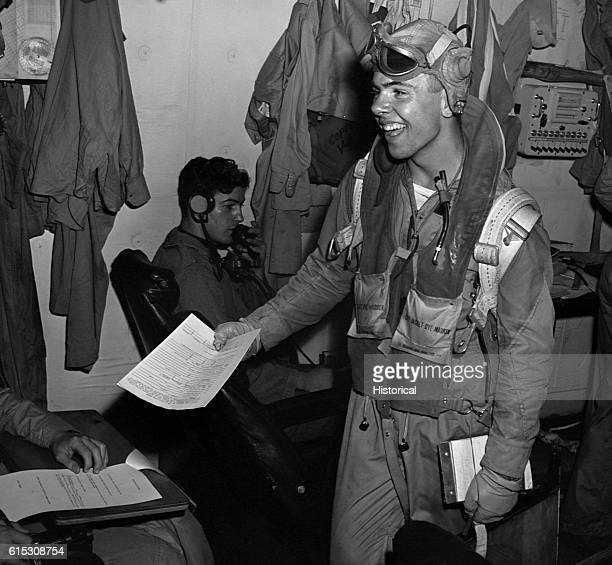After a successful mission a USS Lexington aircrewman turns in a report in the ready room November 1943 | Location USS Lexington